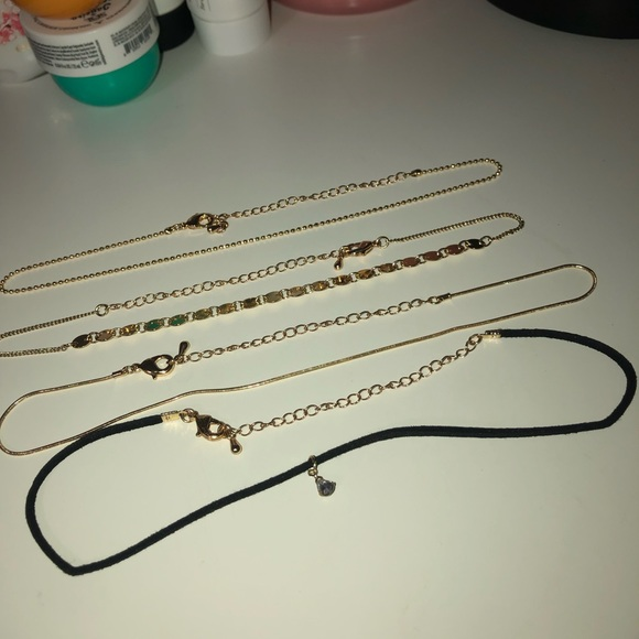 FOUR PIECE LAYERED NECKLACES